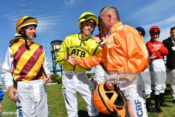 Darren Gauci is congratulated by Ben Allen during a guard of honour from his family friends and fellow jockeys before his last career ride in Race 9...
