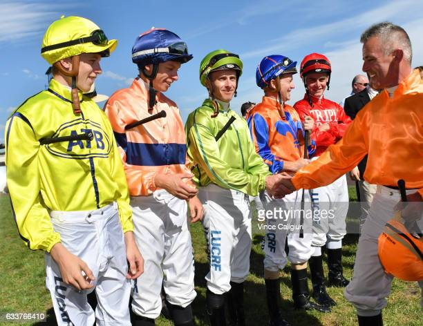 Darren Gauci is congratulated by fellow jockeys during a guard of honour from his family friends and fellow jockeys before his last career ride in...