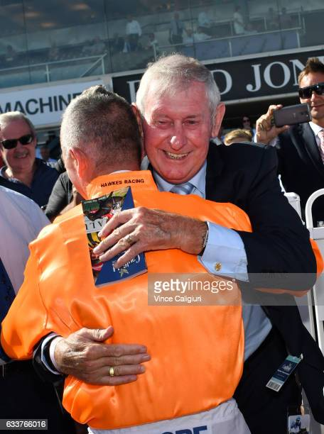 Darren Gauci is congratulated by former jockey Gary Willetts during a guard of honour from his family friends and fellow jockeys before his last...