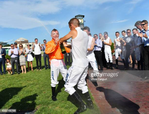 Darren Gauci is sprayed with champagne from Damien Oliver and Mark Zahra after he received guard of honour from his family friends and fellow jockeys...