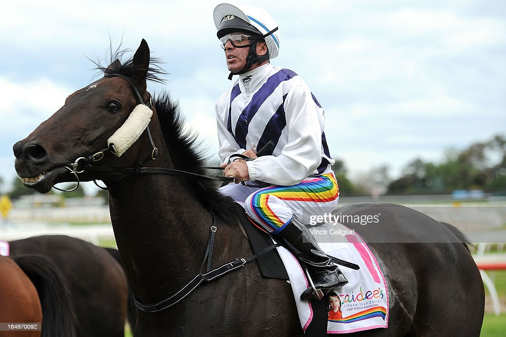 Darren Gauci riding Budriguez after winning the Zaidee's Rainbow Foundation Victoria Handicap during Melbourne Racing at Caulfield Racecourse on March 30, 2013 in Melbourne, Australia.
