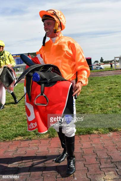 Darren Gauci walks off the track after riding Longeron in his last career ride in Race 9 at Caulfield Racecourse on February 4 2017 in Melbourne...