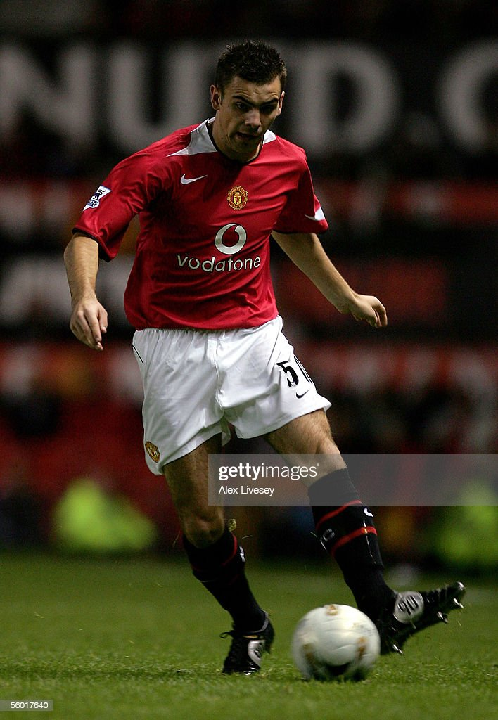 Darren Gibson of Manchester United moves the ball during the Carling Cup third round match between Manchester United and Barnet at Old Trafford on...