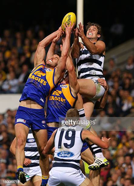 Darren Glass and Eric Mackenzie of the Eagles contest for a mark against Tom Hawkins of the Cats during the round 20 AFL match between the West Coast...
