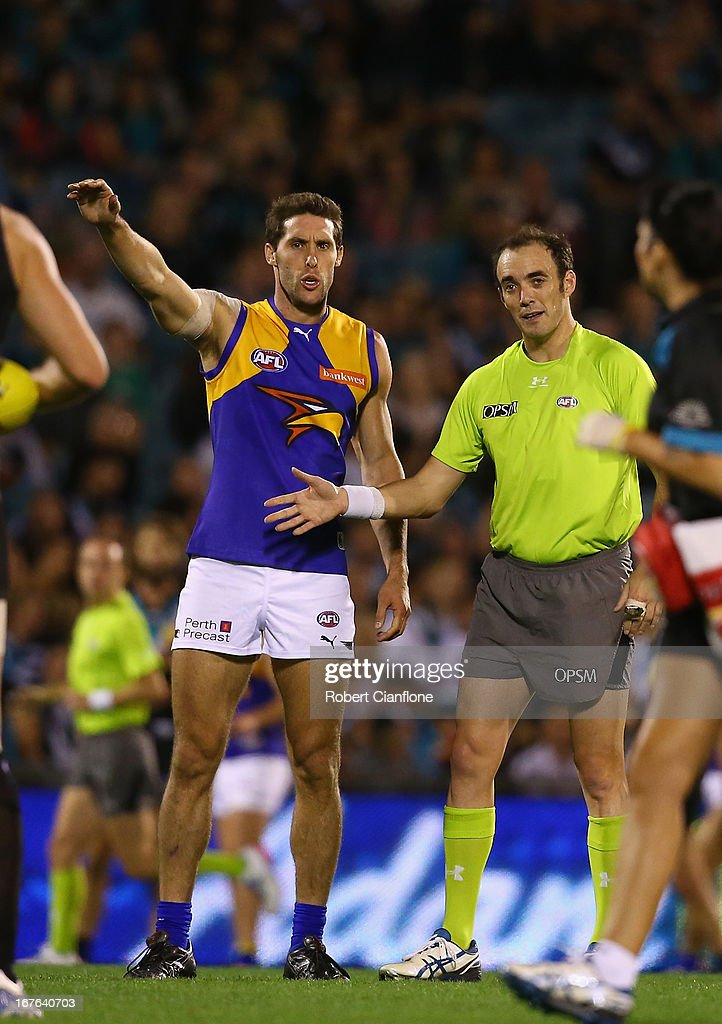 <a gi-track='captionPersonalityLinkClicked' href=/galleries/search?phrase=Darren+Glass&family=editorial&specificpeople=235915 ng-click='$event.stopPropagation()'>Darren Glass</a> of the Eagles is reported by the umpire during the round five AFL match between Port Adelaide Power and the West Coast Eagles at AAMI Stadium on April 27, 2013 in Adelaide, Australia.