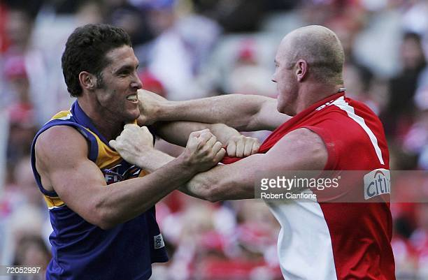 Darren Glass of the Eagles wrestles with Barry Hall of the Swans during the AFL Grand Final match between the Sydney Swans and the West Coast Eagles...