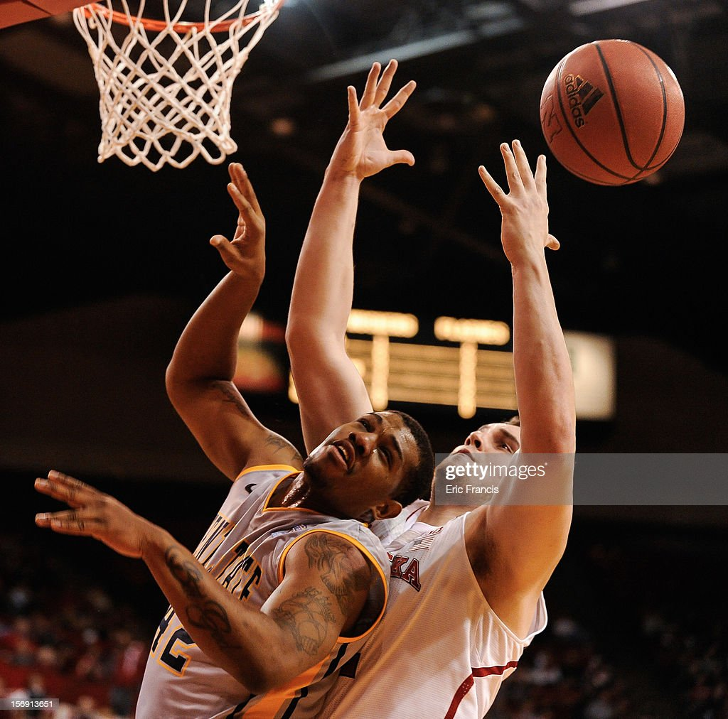 Darren Goodson #42 of the Kent State Golden Flashes fights with Andre Almeida #32 of the Nebraska Cornhuskers for a rebound during their game at The Devaney Center on November 24, 2012 in Lincoln, Nebraska.