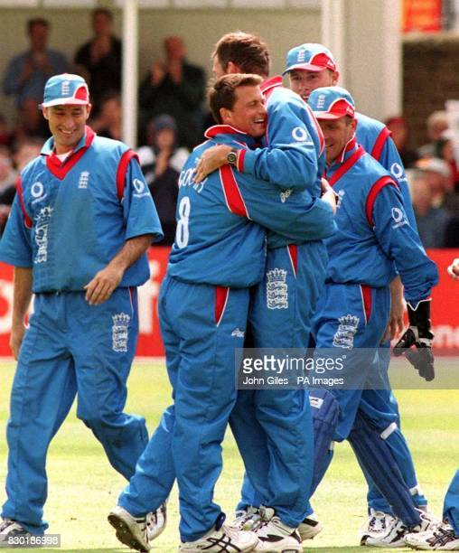 Darren Gough hugs Angus Fraser after Fraser caught Stuart Carlisle off the bowling from Gough for England during the match against Zimbabwe in the...
