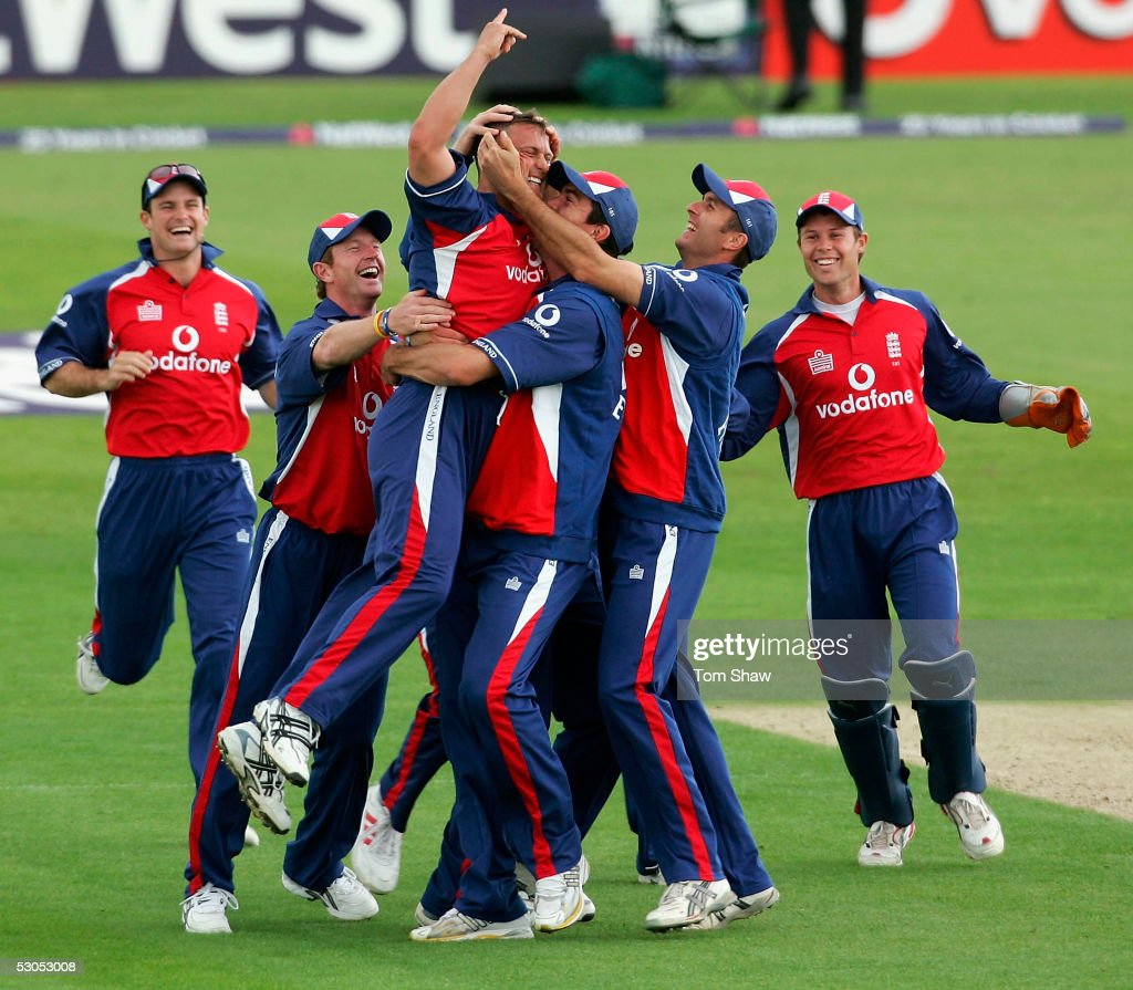 Darren Gough of England is mobbed after taking the wicket of Chris Denham of Hampshire to complete his hat trick during the England v Hampshire One...