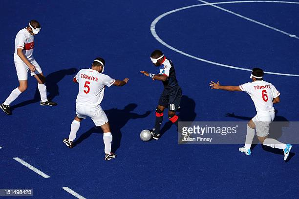 Darren Harris of Great Britain is surrounded by Turkey players in the 78 classification match between Great Britain and Turkey during the 5 aside...