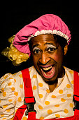 Darren Hart playing 'Jester' poses for a portrait during the Puss in Boots pantomime at the Hackney Empire on December 6 2013 in London England