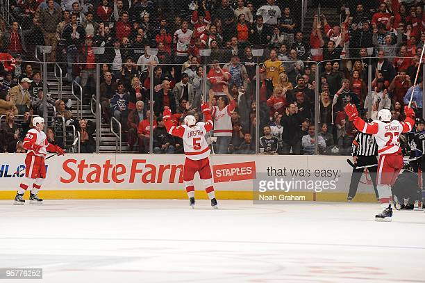Darren Helm Nicklas Lidstrom and Brad Stuart of the Detroit Red Wings celebrate after a goal against the Los Angeles Kings on January 7 2010 at...