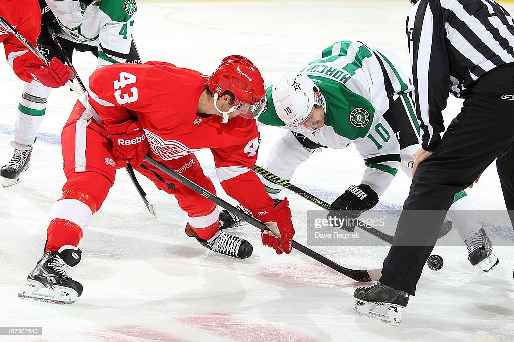 <a gi-track='captionPersonalityLinkClicked' href=/galleries/search?phrase=Darren+Helm&family=editorial&specificpeople=3949334 ng-click='$event.stopPropagation()'>Darren Helm</a> #43 of the Detroit Red Wings and <a gi-track='captionPersonalityLinkClicked' href=/galleries/search?phrase=Shawn+Horcoff&family=editorial&specificpeople=239536 ng-click='$event.stopPropagation()'>Shawn Horcoff</a> #10 of the Dallas Stars face-off during an NHL game at Joe Louis Arena on November 7, 2013 in Detroit, Michigan. Dallas defeated Detroit 4-3 in OT