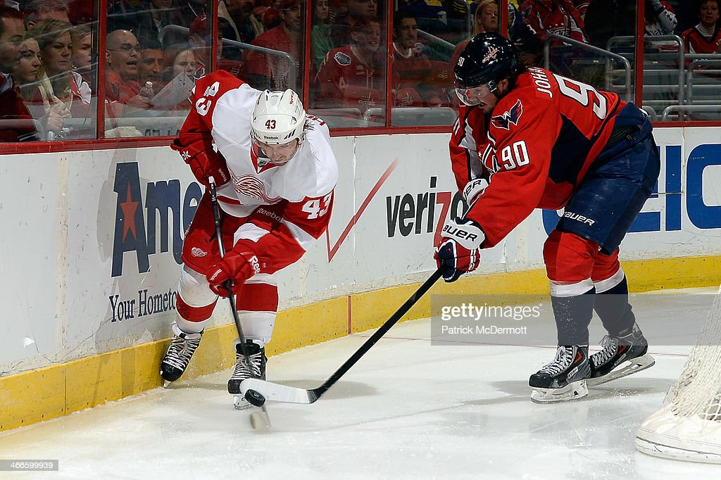 <a gi-track='captionPersonalityLinkClicked' href=/galleries/search?phrase=Darren+Helm&family=editorial&specificpeople=3949334 ng-click='$event.stopPropagation()'>Darren Helm</a> #43 of the Detroit Red Wings battles for the puck againd <a gi-track='captionPersonalityLinkClicked' href=/galleries/search?phrase=Marcus+Johansson&family=editorial&specificpeople=4247883 ng-click='$event.stopPropagation()'>Marcus Johansson</a> #90 of the Washington Capitals in the third period during an NHL game at Verizon Center on February 2, 2014 in Washington, DC.