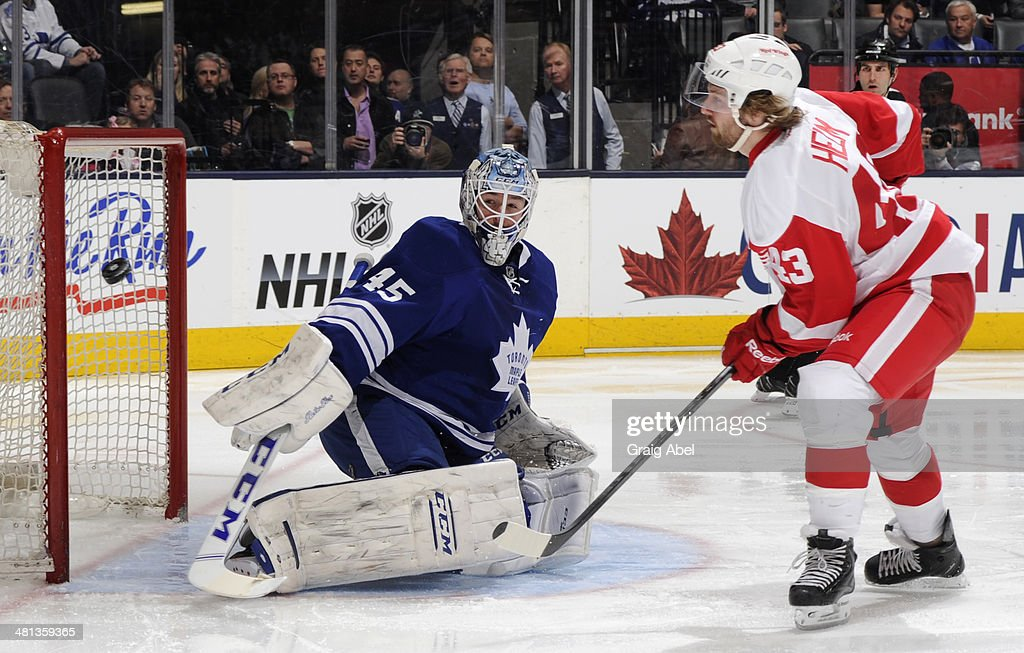 Darren Helm #43 of the Detroit Red Wings is stopped in close by Jonathan Bernier #45 of the Toronto Maple Leafs during NHL game action March 29, 2014 at the Air Canada Centre in Toronto, Ontario, Canada.