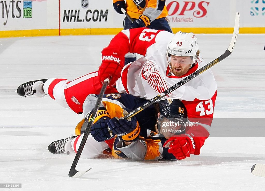 <a gi-track='captionPersonalityLinkClicked' href=/galleries/search?phrase=Darren+Helm&family=editorial&specificpeople=3949334 ng-click='$event.stopPropagation()'>Darren Helm</a> #43 of the Detroit Red Wings lands on <a gi-track='captionPersonalityLinkClicked' href=/galleries/search?phrase=Marcus+Foligno&family=editorial&specificpeople=5662790 ng-click='$event.stopPropagation()'>Marcus Foligno</a> #82 of the Buffalo Sabres while battling for the puck on April 8, 2014 at the First Niagara Center in Buffalo, New York.