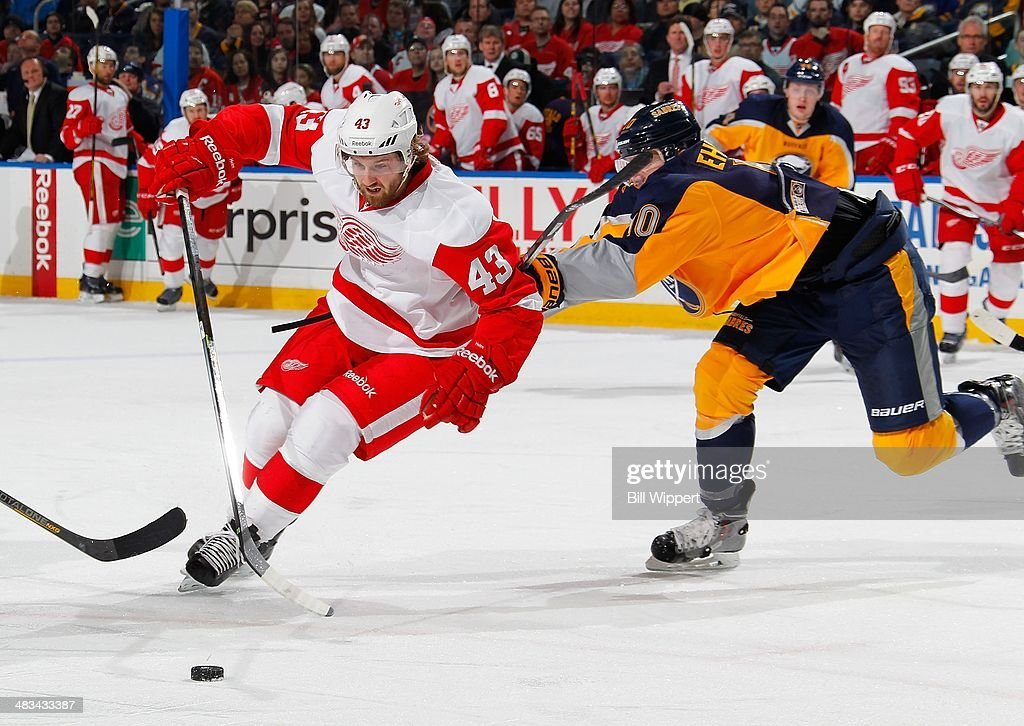 <a gi-track='captionPersonalityLinkClicked' href=/galleries/search?phrase=Darren+Helm&family=editorial&specificpeople=3949334 ng-click='$event.stopPropagation()'>Darren Helm</a> #43 of the Detroit Red Wings looks to get by <a gi-track='captionPersonalityLinkClicked' href=/galleries/search?phrase=Christian+Ehrhoff&family=editorial&specificpeople=214788 ng-click='$event.stopPropagation()'>Christian Ehrhoff</a> #10 of the Buffalo Sabres on April 8, 2014 at the First Niagara Center in Buffalo, New York.