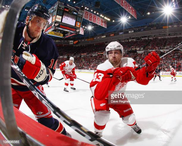 Darren Helm of the Detroit Red Wings pursues Marian Gaborik of the New York Rangers during an NHL game at Joe Louis Arena on February 7 2011 in...