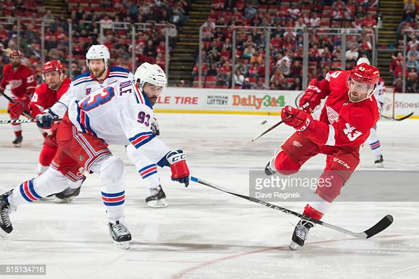 Darren Helm of the Detroit Red Wings scores a slap shot goal in front of Keith Yandle of the New York Rangers during an NHL game at Joe Louis Arena...