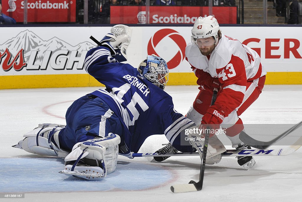 Darren Helm #43 of the Detroit Red Wings scores his third goal of the game on Jonathan Bernier #45 of the Toronto Maple Leafs during NHL game action March 29, 2014 at the Air Canada Centre in Toronto, Ontario, Canada.