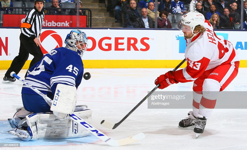Darren Helm #43 of the Detroit Red Wings shoots the puck against Jonathan Bernier #45 of the Toronto Maple Leafs during NHL action at the Air Canada Centre march 29, 2014 in Toronto, Ontario, Canada.