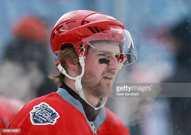 Darren Helm of the Detroit Red Wings skates during 2014 Bridgestone NHL Winter Classic team practice session on December 31 2013 at Michigan Stadium...