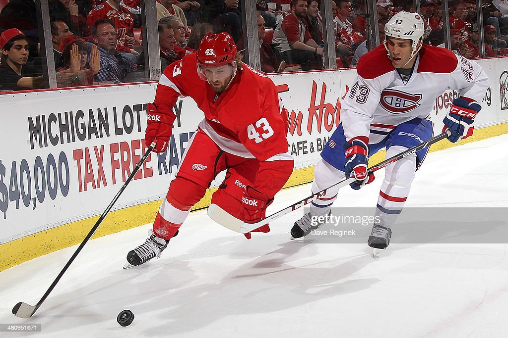 <a gi-track='captionPersonalityLinkClicked' href=/galleries/search?phrase=Darren+Helm&family=editorial&specificpeople=3949334 ng-click='$event.stopPropagation()'>Darren Helm</a> #43 of the Detroit Red Wings skates with the puck as Mike Weaver #43 of the Montreal Canadiens pressures him during an NHL game on March 27, 2014 at Joe Louis Arena in Detroit, Michigan.