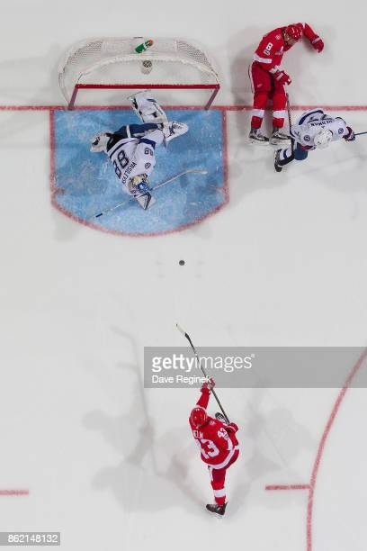 Darren Helm of the Detroit Red Wings takes a shoot on goaltender Andrei Vasilevskiy of the Tampa Bay Lightning after Justin Abdelkader of the Wings...
