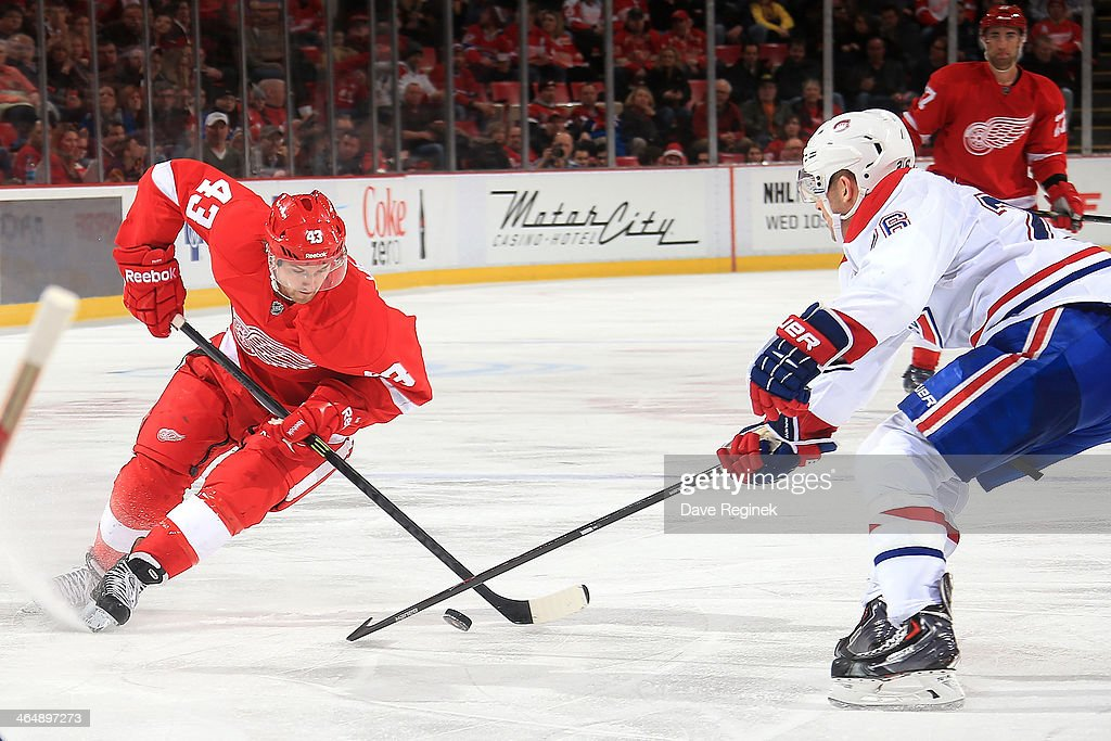 <a gi-track='captionPersonalityLinkClicked' href=/galleries/search?phrase=Darren+Helm&family=editorial&specificpeople=3949334 ng-click='$event.stopPropagation()'>Darren Helm</a> #43 of the Detroit Red Wings tries to make a move on <a gi-track='captionPersonalityLinkClicked' href=/galleries/search?phrase=Josh+Gorges&family=editorial&specificpeople=550446 ng-click='$event.stopPropagation()'>Josh Gorges</a> #26 of the Montreal Canadiens in open ice during an NHL game on January 24, 2014 at Joe Louis Arena in Detroit, Michigan. Detroit defeated Montreal 4-1