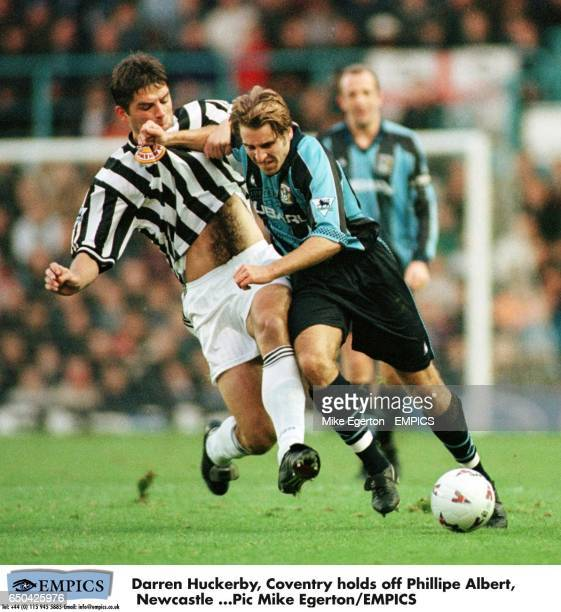 Darren Huckerby of Coventry City holds off Philippe Albert of Newcastle United