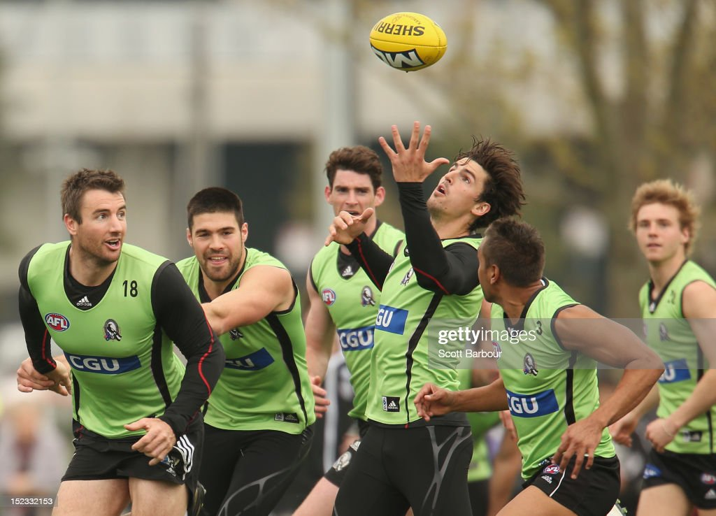 Darren Jolly, Chris Dawes, Tyson Goldsack and Scott Pendlebury of the Magpies compete for the ball during a Collingwood Magpies AFL training session at Gosch's Paddock on September 19, 2012 in Melbourne, Australia.
