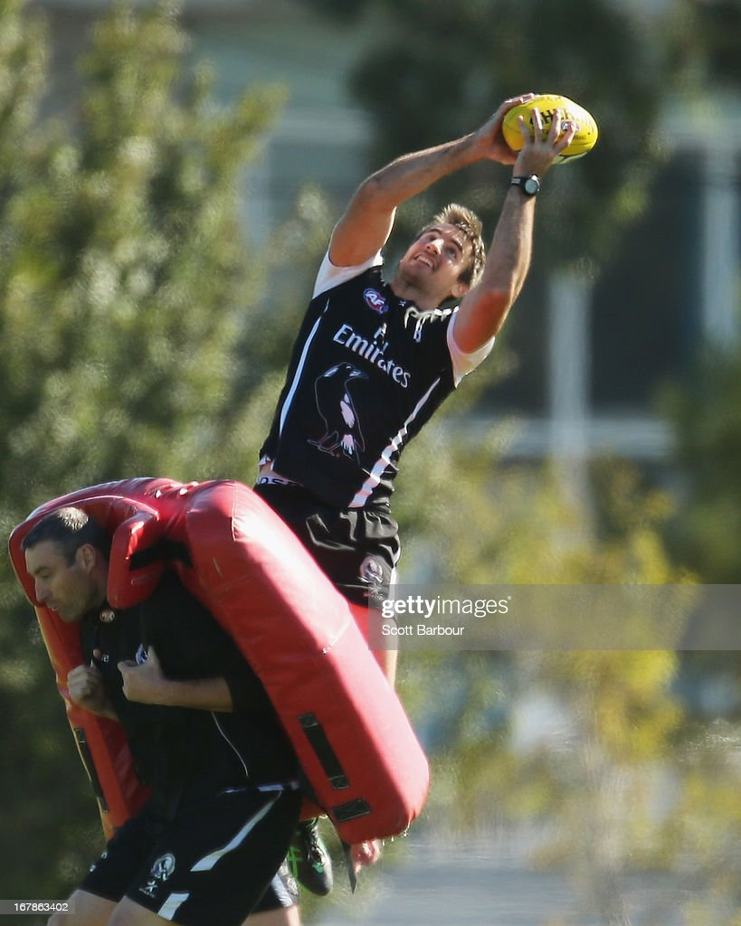 <a gi-track='captionPersonalityLinkClicked' href=/galleries/search?phrase=Darren+Jolly&family=editorial&specificpeople=214119 ng-click='$event.stopPropagation()'>Darren Jolly</a> of the Magpies marks the ball during a Collingwood Magpies AFL training session at Olympic Park on May 2, 2013 in Melbourne, Australia.