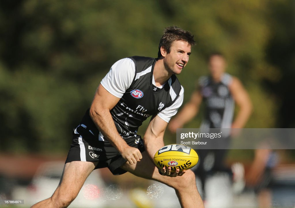Darren Jolly of the Magpies passes the ball during a Collingwood Magpies AFL training session at Olympic Park on May 2, 2013 in Melbourne, Australia.