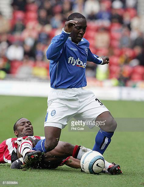 Darren Kenton of Southampton tackles Dwight Yorke of Birmingham City during the Barclays Premiership match between Southampton and Birmingham City at...