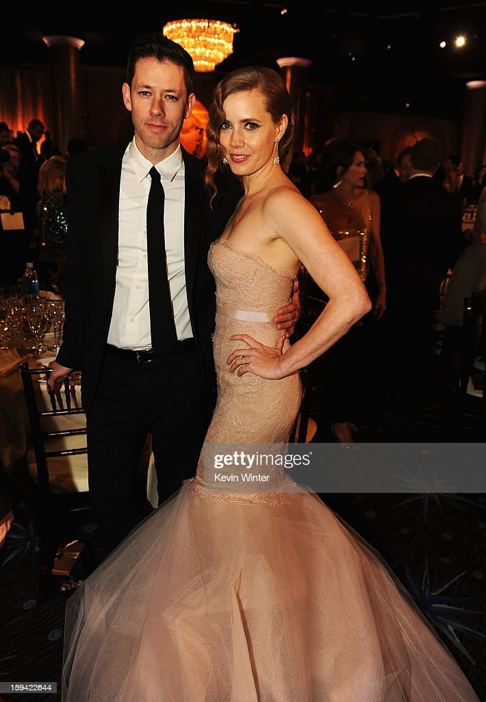 Darren Le Gallo (L) and actress Amy Adams attend the 70th Annual Golden Globe Awards Cocktail Party held at The Beverly Hilton Hotel on January 13, 2013 in Beverly Hills, California.