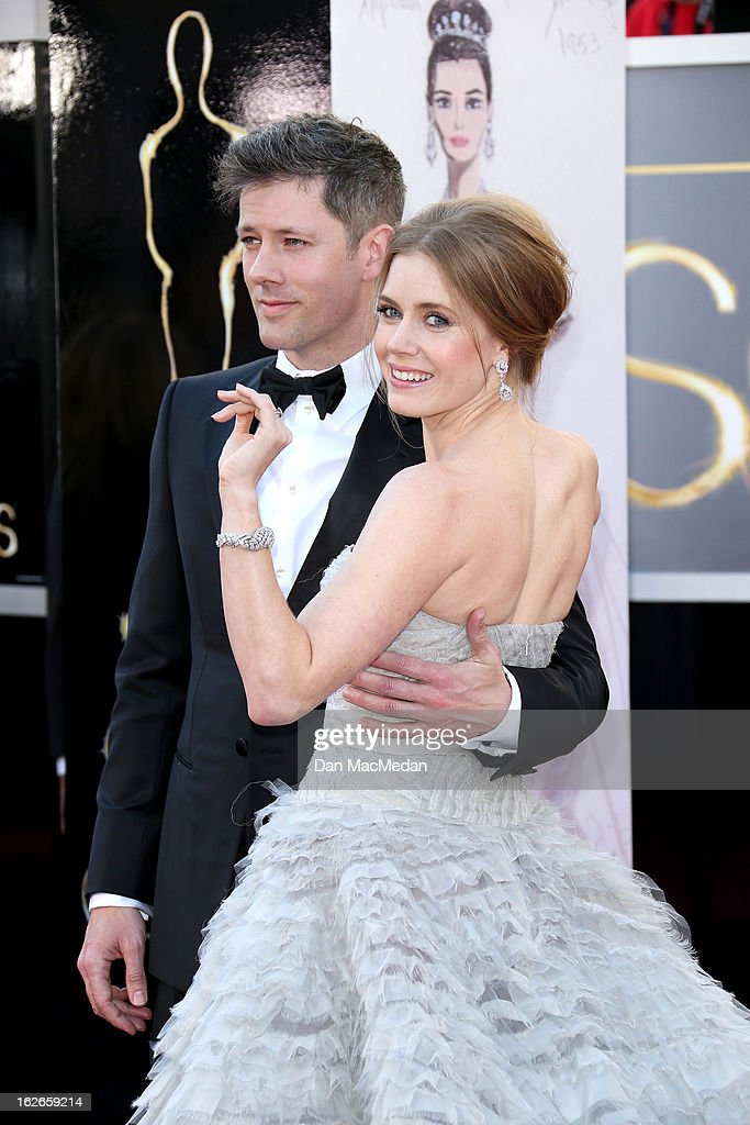 Darren Le Gallo and Amy Adams arrive at the 85th Annual Academy Awards at Hollywood & Highland Center on February 24, 2013 in Hollywood, California.