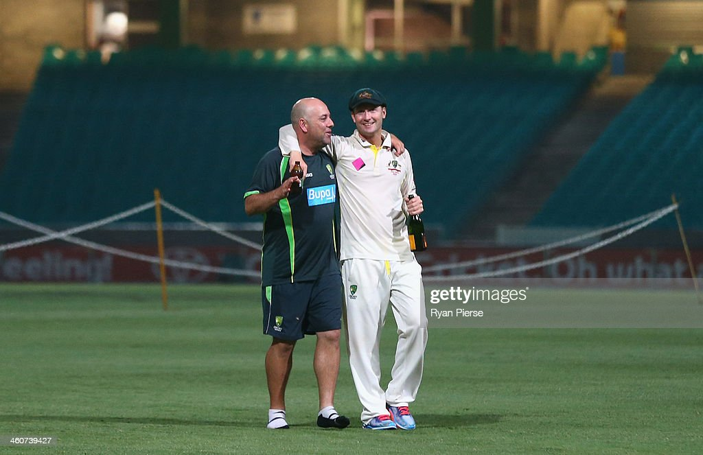 Darren Lehmann, coach of Australia, and Michael Clarke of Australia talk on the pitch at midnight after day three of the Fifth Ashes Test match between Australia and England at Sydney Cricket Ground on January 5, 2014 in Sydney, Australia.
