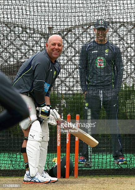 Darren Lehmann coach of Australia bats in the nets as Michael Clarke of Australia looks on during an Australian Training Session at The County Ground...