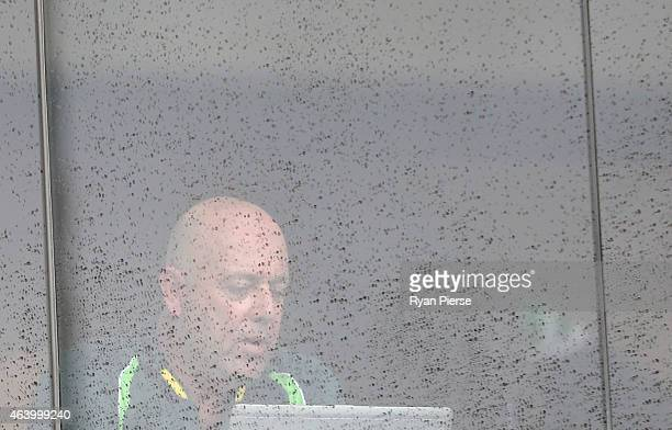Darren Lehmann coach of Australia looks on as rain delays the start of play during the 2015 ICC Cricket World Cup match between Australia and...