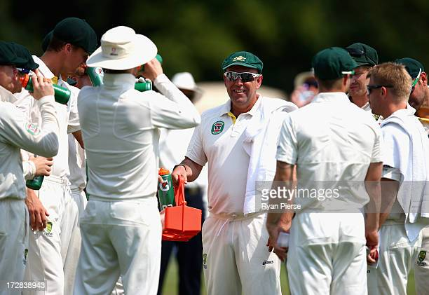 Darren Lehmann coach of Australia runs drinks out to his players during day three of the Tour Match between Worcestershire and Australia at New Road...