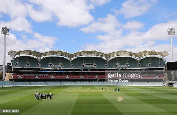 Darren Lehmann coach of Australia speaks to the players in a huddle during an Australian nets session at Adelaide Oval on December 6 2014 in Adelaide...