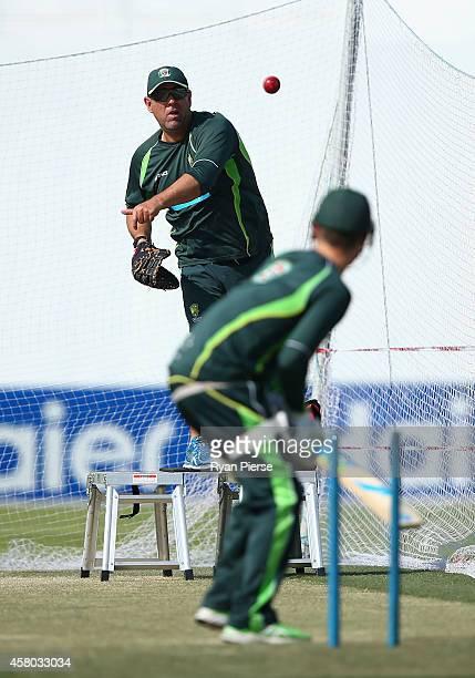 Darren Lehmann coach of Australia throws balls to Michael Clarke of Australia during an Australian Nets Session at Sheikh Zayed Cricket Stadium on...