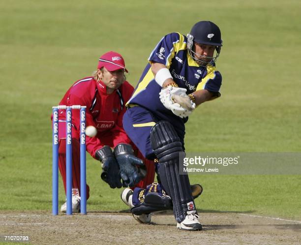 Darren Lehmann of Yorkshire sweeps the ball as Luke Sutton Lancashire looks on during the Cheltenham and Gloucester Trophy match between Yorkshire...