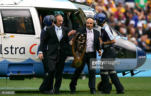 Darren Lockyer of the Broncos and Hazem El Masri of the Bulldogs deliver the NRL Premiership trophy prior to the 2009 NRL Grand Final match between...