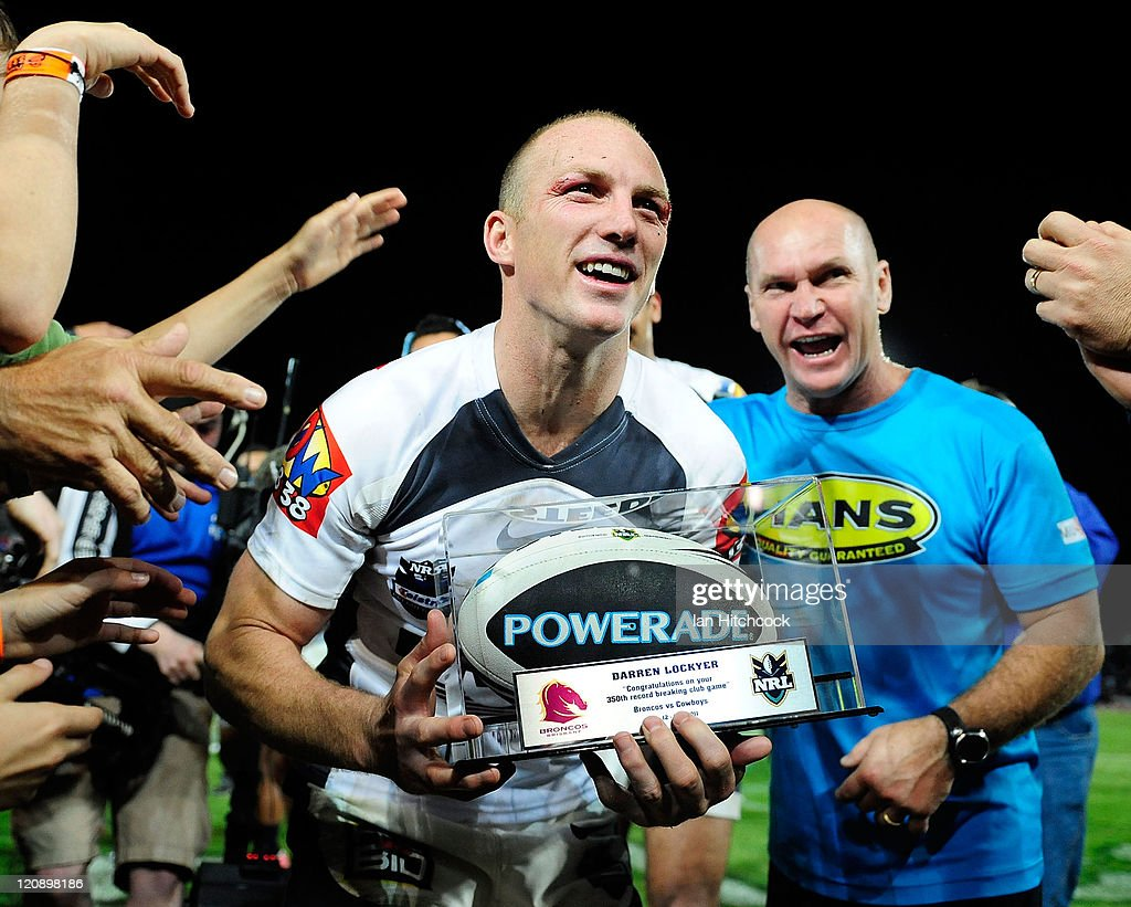 <a gi-track='captionPersonalityLinkClicked' href=/galleries/search?phrase=Darren+Lockyer&family=editorial&specificpeople=206303 ng-click='$event.stopPropagation()'>Darren Lockyer</a> of the Broncos comes off the field through a team honour guard at the end of the round 23 NRL match between the North Queensland Cowboys and the Brisbane Broncos at Dairy Farmers Stadium on August 12, 2011 in Townsville, Australia.