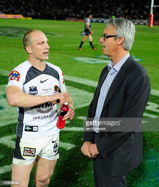 Darren Lockyer of the Broncos speaks to NRL CEO David Gallop after playing his 350th NRL match at the end of the round 23 NRL match between the North...