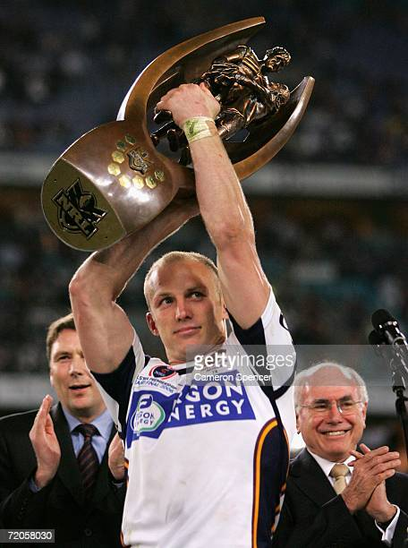 Darren Lockyer of the Broncos watched by Australian Prime Minister John Howard celebrates winning the NRL Grand Final between the Brisbane Broncos...