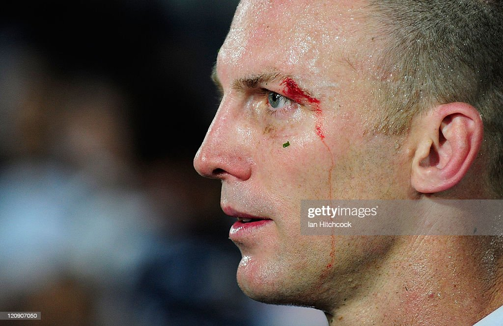 <a gi-track='captionPersonalityLinkClicked' href=/galleries/search?phrase=Darren+Lockyer&family=editorial&specificpeople=206303 ng-click='$event.stopPropagation()'>Darren Lockyer</a> of the Broncos who has just payed his 350th NRL match gives a media interview at the end of the round 23 NRL match between the North Queensland Cowboys and the Brisbane Broncos at Dairy Farmers Stadium on August 12, 2011 in Townsville, Australia.