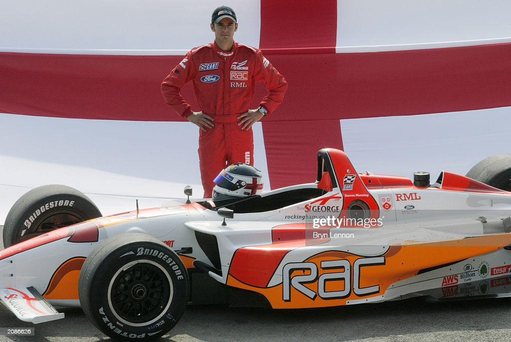 Darren Manning of Great Britain poses with the Team St George Champ car during the official launch of Team St George in the CART Fedex Championship at Brooklands Museum, Weybridge on September 5, 2002.