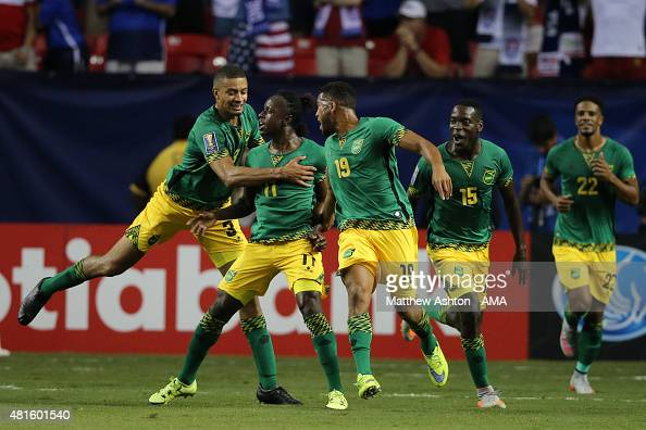 Darren Mattocks of Jamaica celebrates after scoring a goal to make it 01 during the Gold Cup Semi Final between USA and Jamaica at Georgia Dome on...